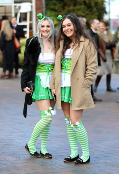 Bethany Ford and Georgia Garbett from Evesham during St Patrick's Thursday.