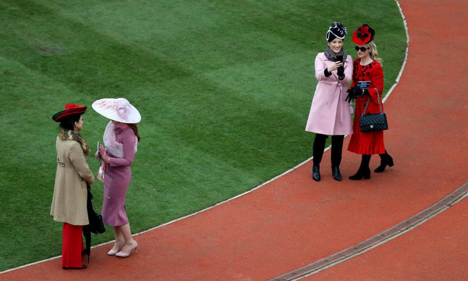 Racegoers during Ladies Day. Nigel French/PA
