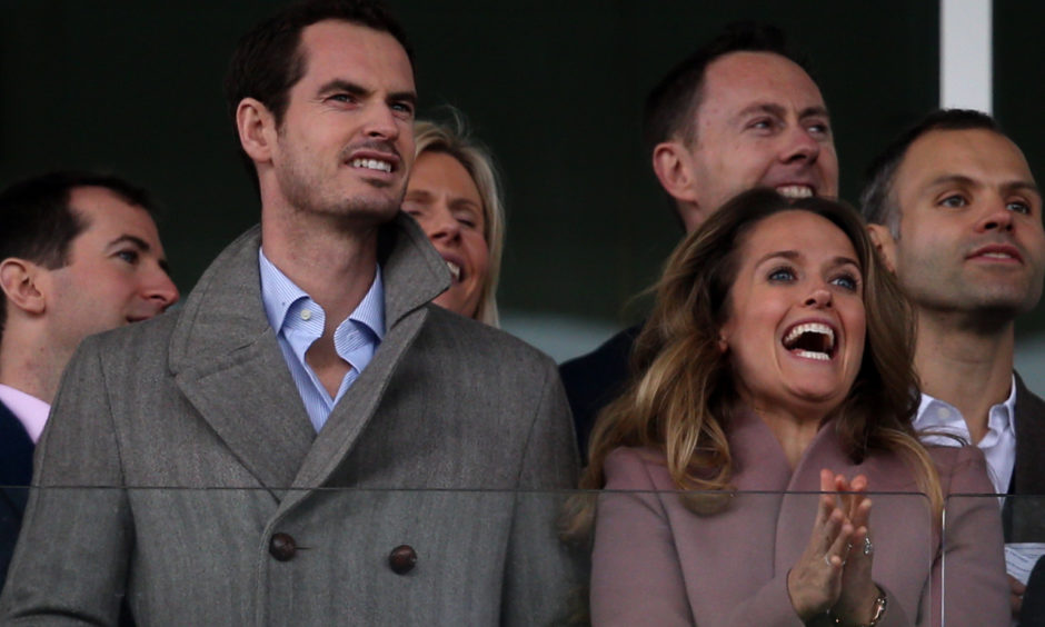 Andy Murray and wife Kim watch the action. Aaron Chown/PA