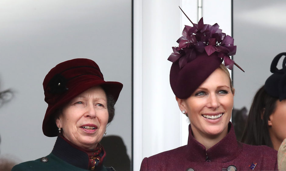 The Princess Royal and Zara Tindall watch the race action. Andrew Matthews/PA