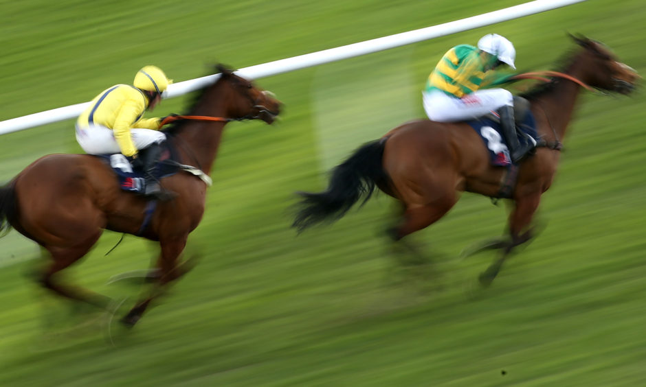 Defi Du Seuil ridden by Barry Geraghty on their way to winning the JLT Novices' Chase during St Patrick's Thursday.
