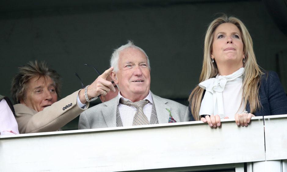 Rod Stewart (left), Graham Lancaster and Penny Stewart during St Patrick's Thursday at Cheltenham Racecourse.