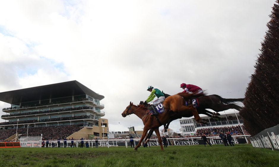 Topofthegame ridden by Harry Cobden on their way to victory in the RSA Insurance Novices' Chase. Nigel French/PA