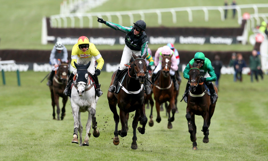 Altior ridden by jockey Nico de Boinville wins the Betway Queen Mother Champion Chase. Paul Harding/PA