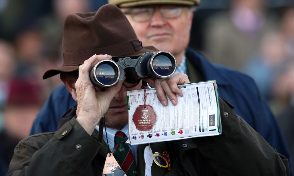 A spectator watches the action. Andrew Matthews/PA