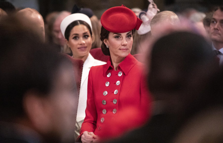 The Duchess of Cambridge (right) with the Duchess of Sussex (left) as they attend the Commonwealth Service at Westminster Abbey, London