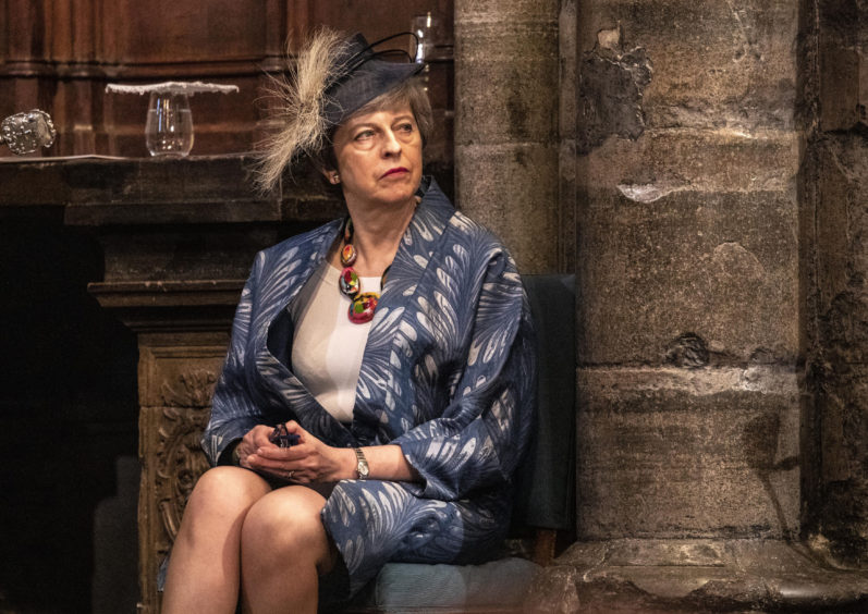 Prime Minister Theresa May waits to give a reading at the Commonwealth Service at Westminster Abbey, London.