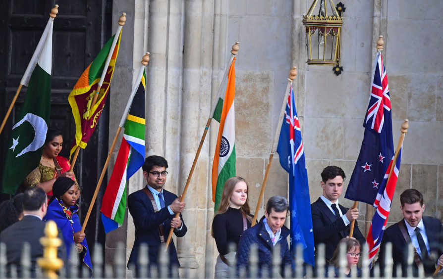 Flag bearers leave after the Commonwealth Service at Westminster Abbey, London.