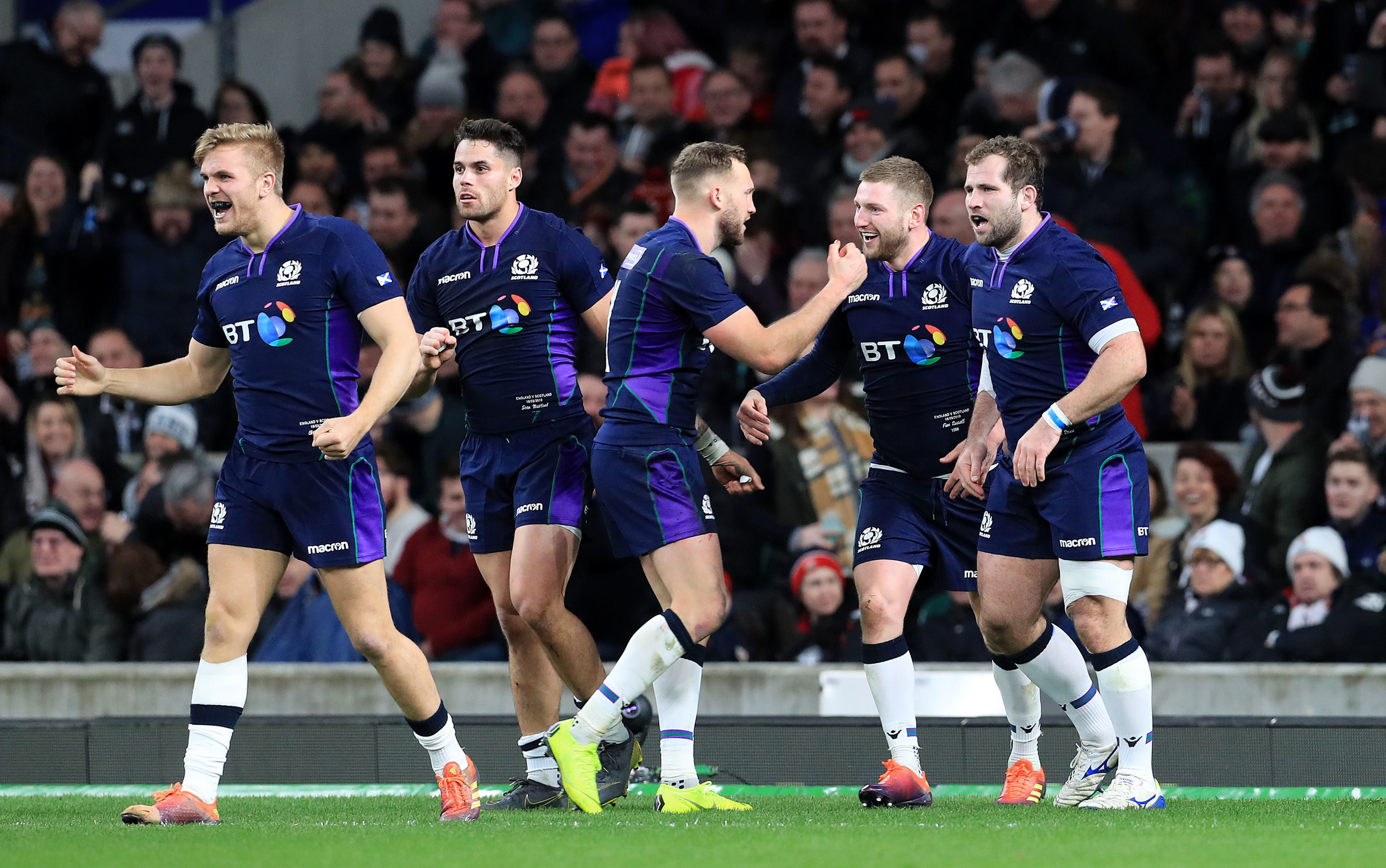 Finn Russell celebrates his try with team-mates at Twickenham during the 2019 Calcutta Cup.