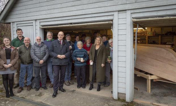 MSP John Swinney meets volunteers at Loch Tay