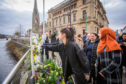 People brought flowers to pay their respects at the Peace Vigil in Perth.