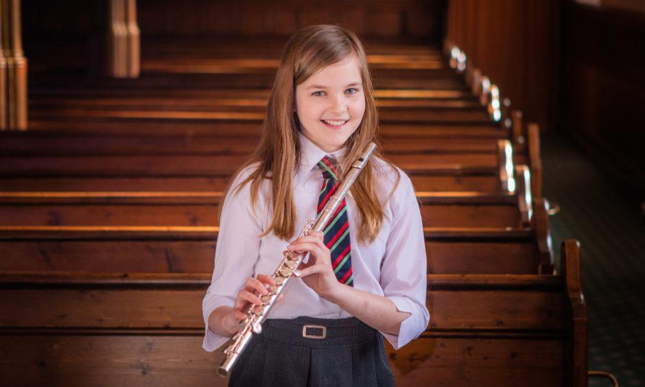 Ella MacDonald (Robert Douglas Memorial School), first place Flute Solo (Beginners) class.