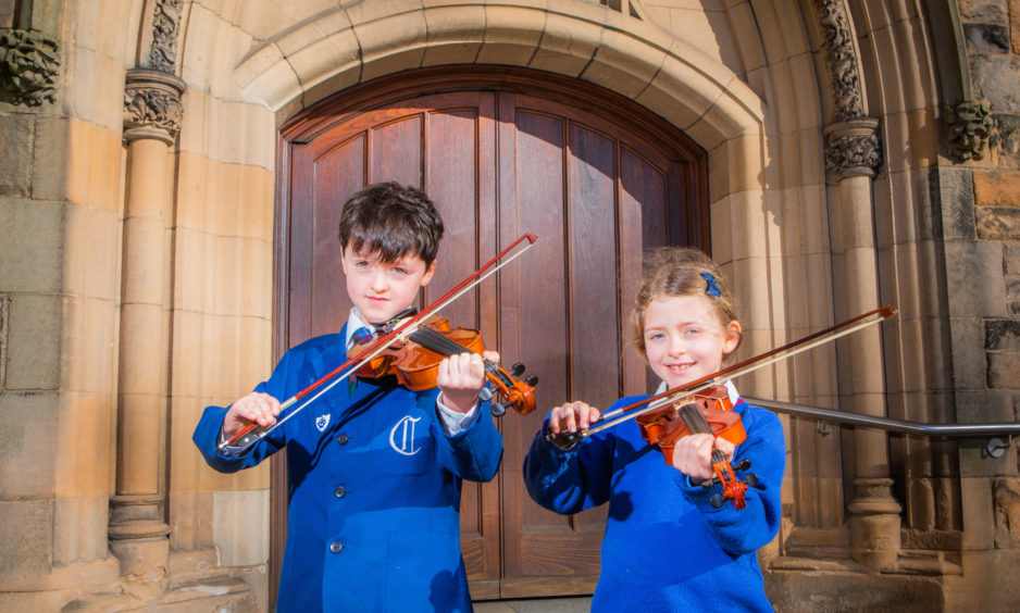 Violin classes. Picture shows Craigclowan School pupils Rose Howison (right, first place in class) and Gregory Bruce (left, second place in class) -- 1st and 2nd in the String Solo (initial) class.