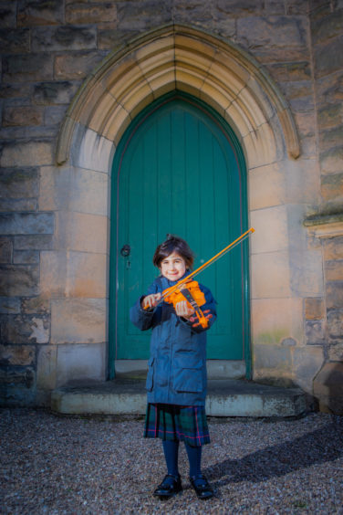 Violin classes. Picture shows Eilidh McPherson (Morrison's Academy, aged 6) first place (only entrant) in Violin Solo (Initial) class -- also her first ever public performance. St Leonard's in the Fields Church, Marshall Place, Perth.