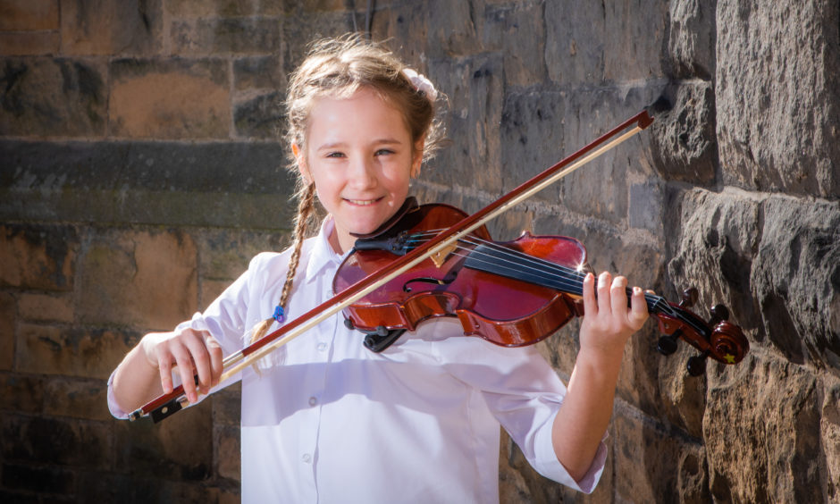 Violin classes. Picture shows Julia Pojda (Inchview Primary School), first place in the Violin Solo (Elementary) class.