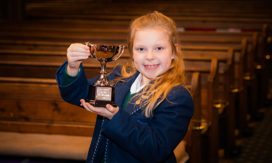 Vocals classes. Picture shows Chloe Bloice (Kilgraston School) winner of The Dalavich Cup for the Vocal Solo - Scots Songs, Boys or Girls aged under 10 class. St Leonard's in the Fields Church, Marshall Place, Perth.