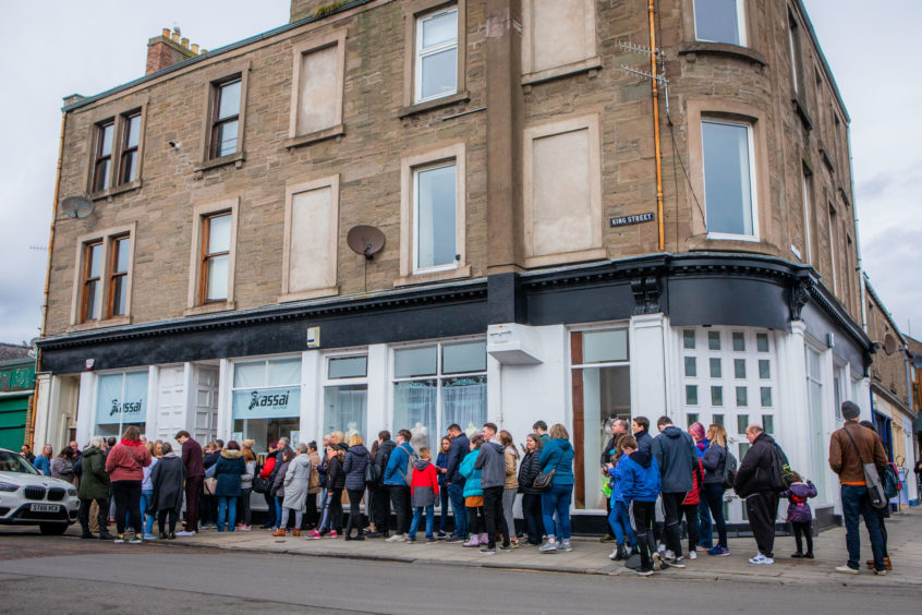 The queue of fans to see Tom Walker at Assai Records.