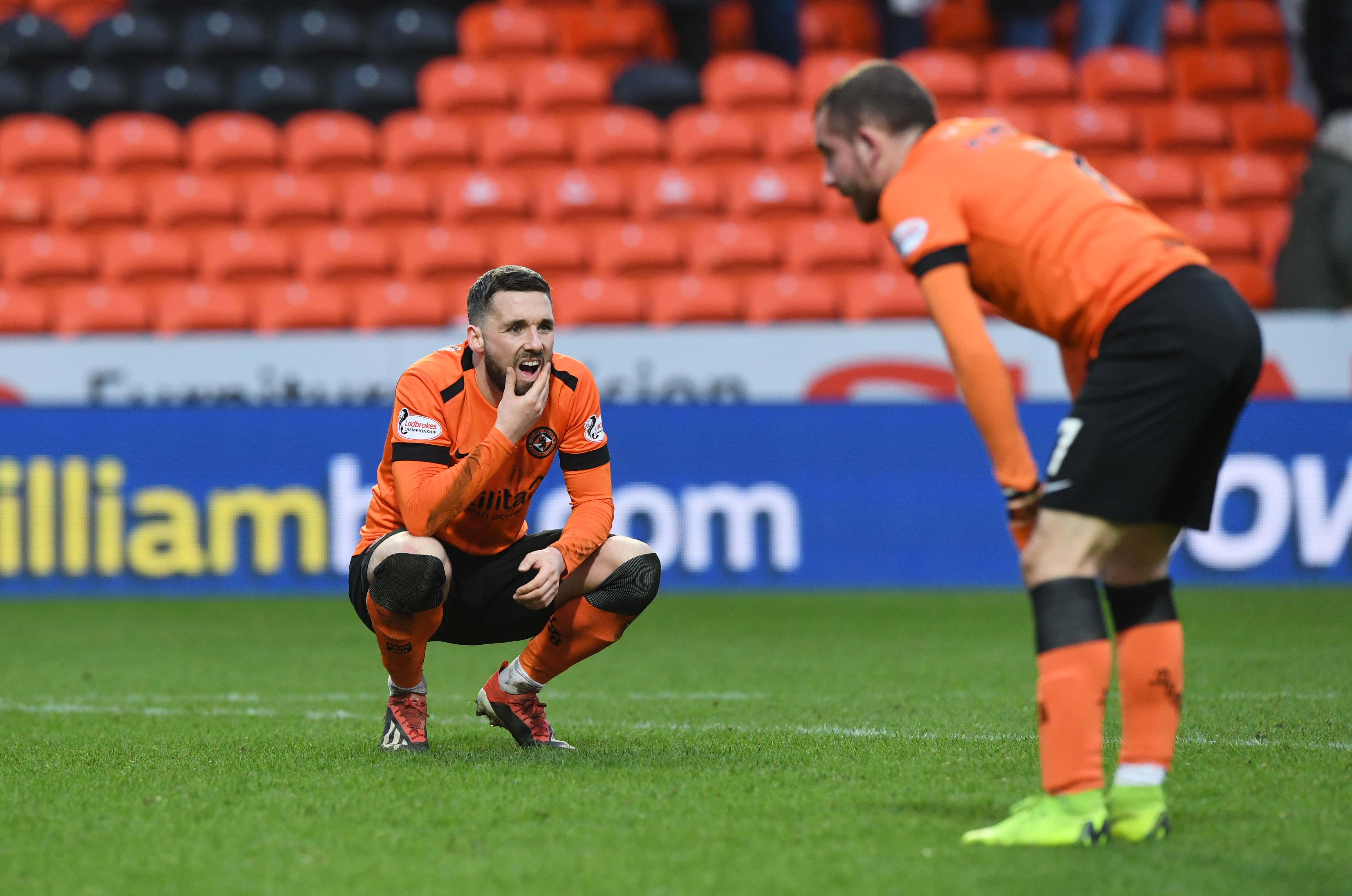 United players Nicky Clark and Paul McMullan look dejected at full-time.