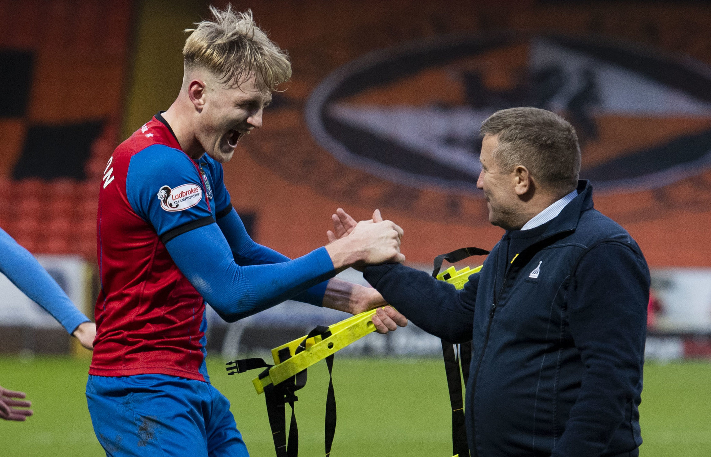 Coll Donaldson celebrates with boss John Robertson after the full-time whistle.