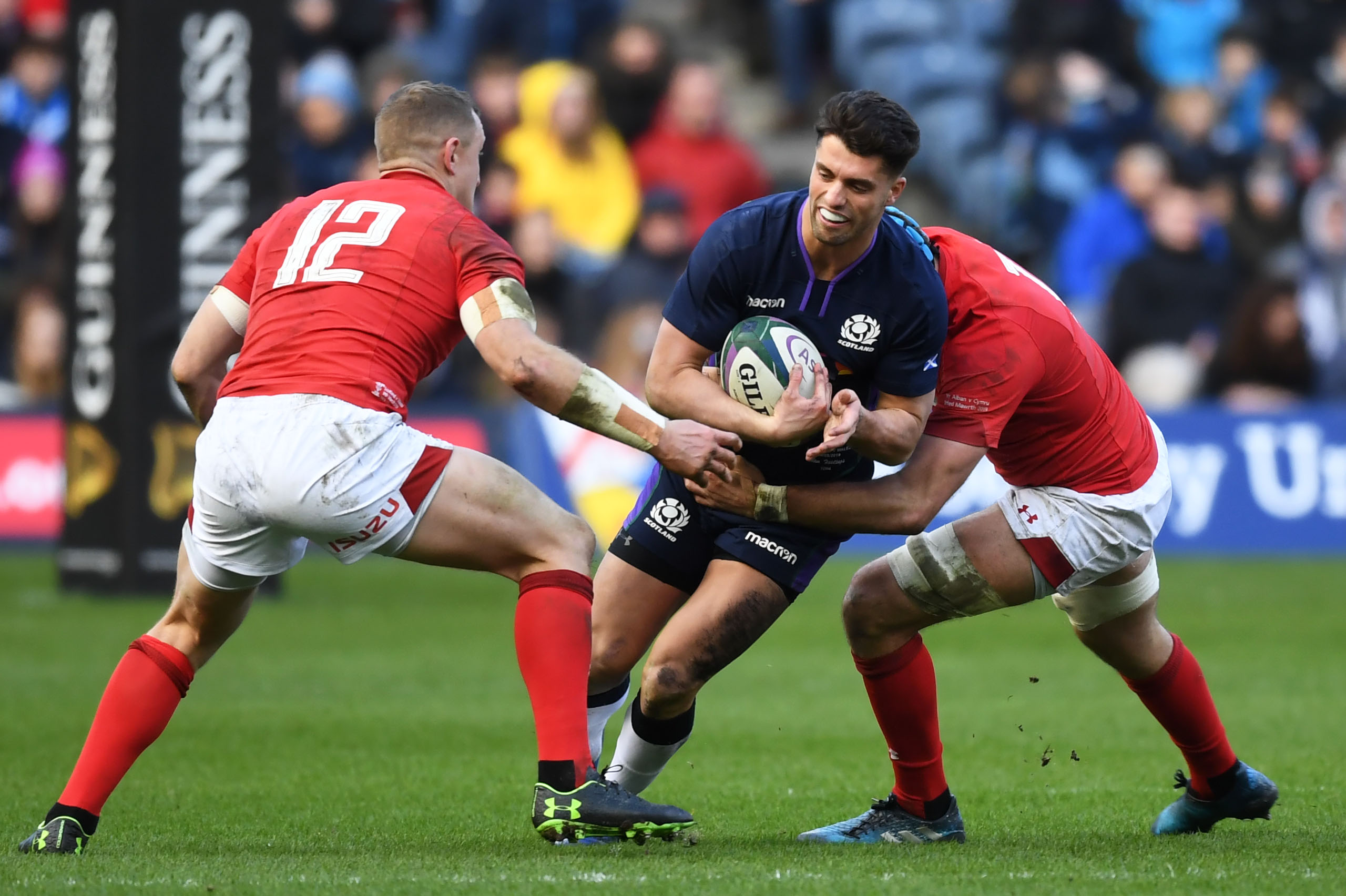 Adam Hastings tries to breach the Welsh defence.