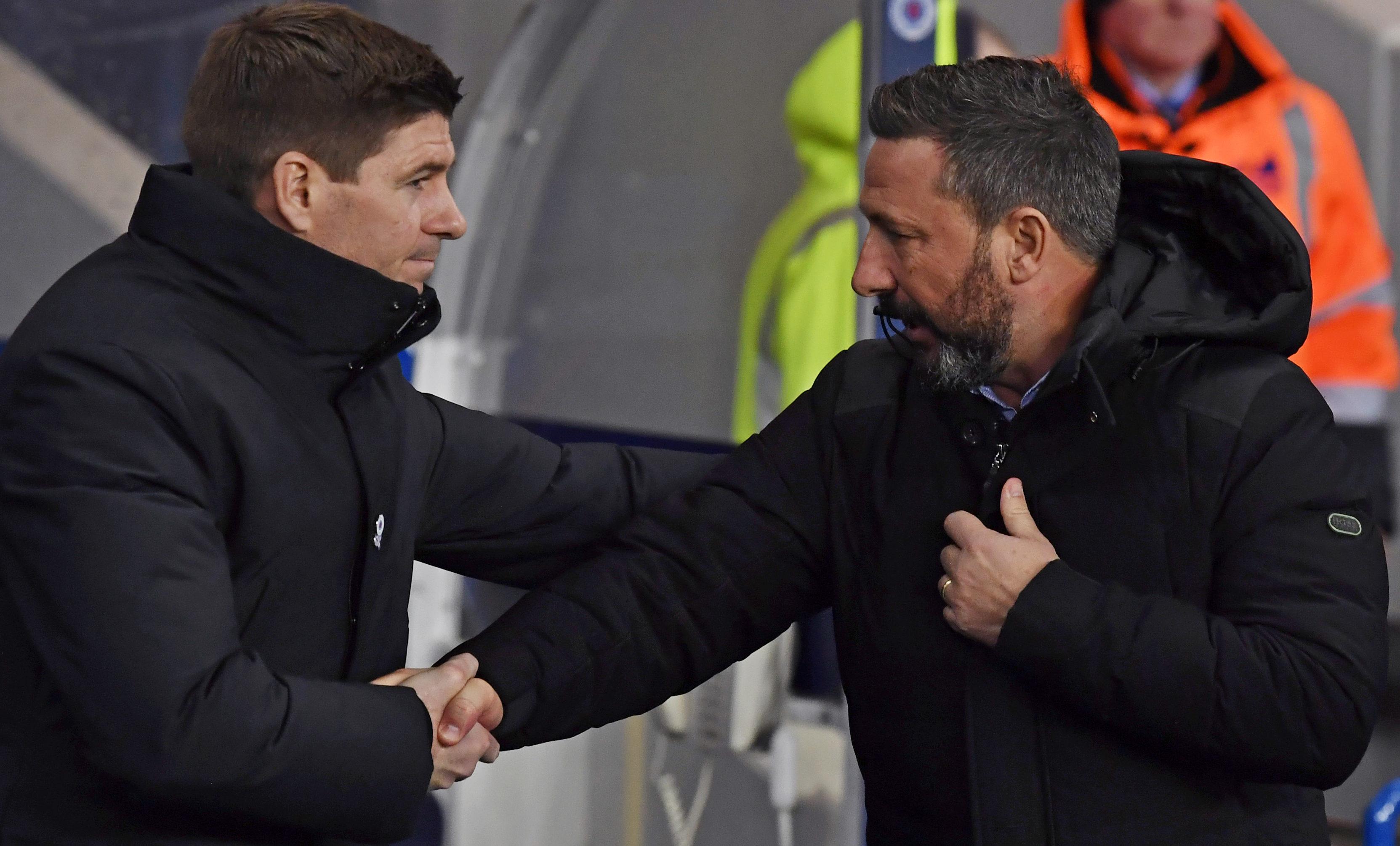 Steven Gerrard, right, shakes hands with Aberdeen boss Derek McInnes on Tuesday night.