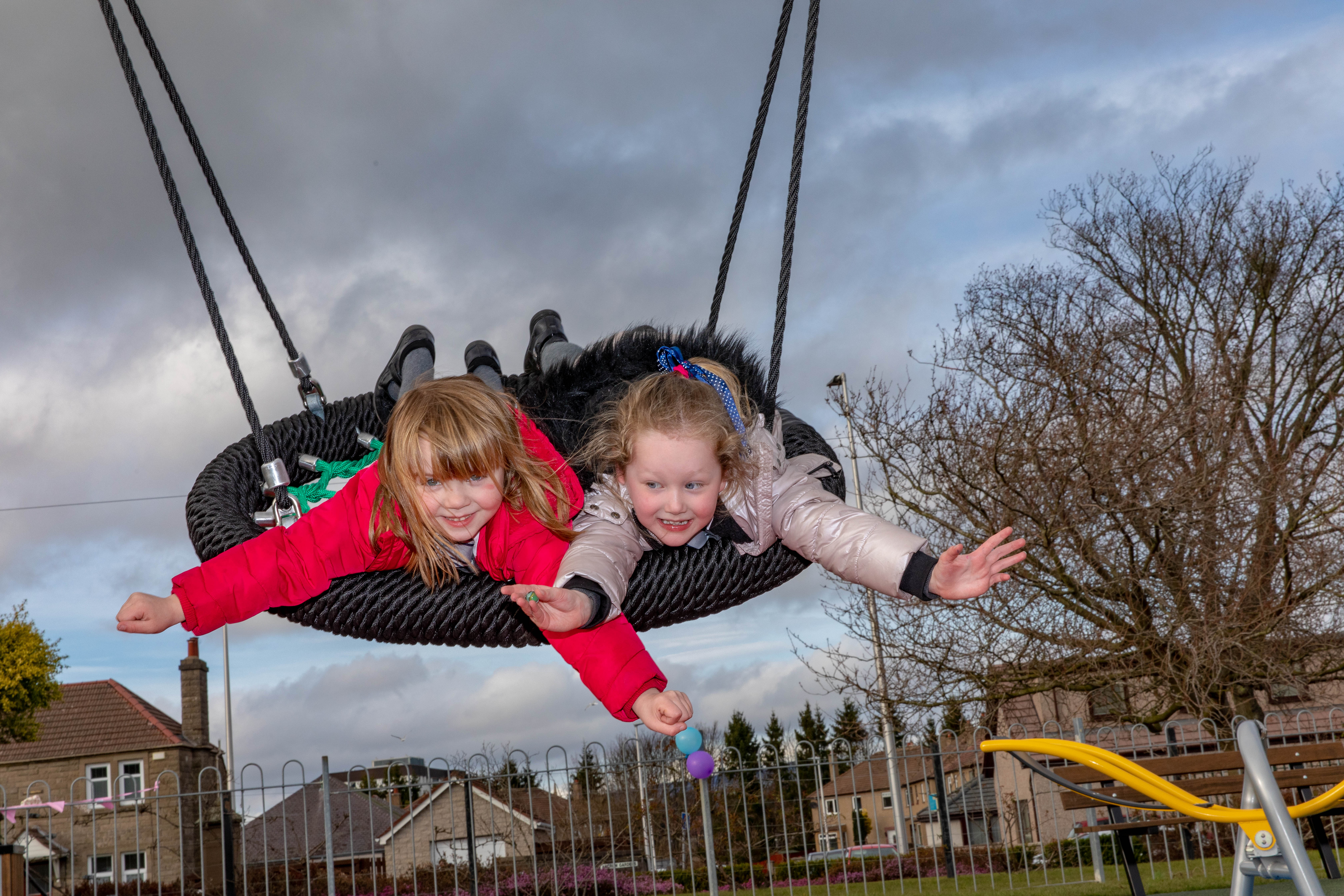 Youngsters Ruby Gardner and Lucy Hutchison, of Locheem, Dundee, on the swing