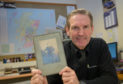 Ron Mitchell the boss of Dundee firm Intona holds a  photograph of his late grandfather William Orchiston who lost his leg at the Somme in 1916.