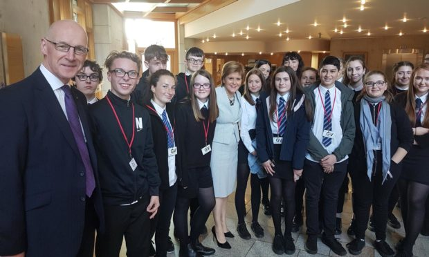Perth Academy students meet John Swinney and Nicola Sturgeon at the Hand of Glove exhibition in Holyrood