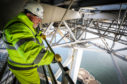 Robert McCulloch, Senior Civil Engineer in charge of  replacing expansion joints on the Forth Road bridge, on one of the underside gantries