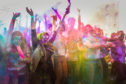 Students and staff of Dundee University celebrate Holi by throwing colour at each other
