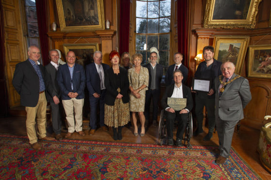 Finalists and judges in the competition with Angus Provost Ronnie Proctor (front right)