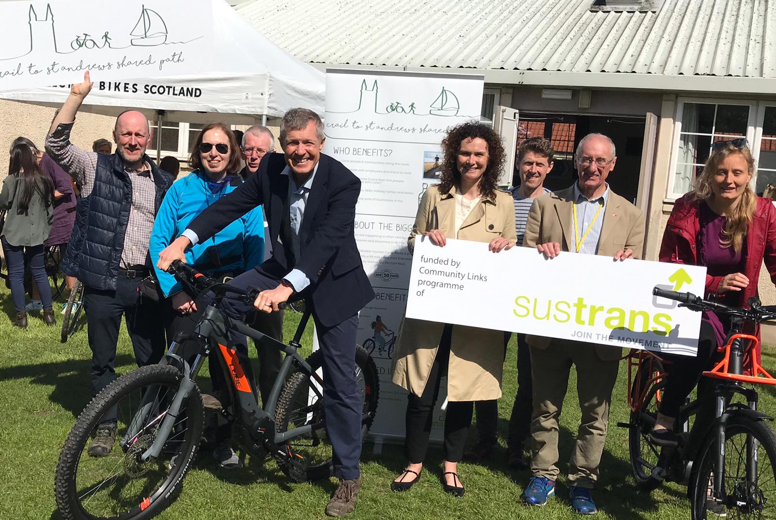 Wille Rennie on his bike, Wendy Chamberlain and Liberal Democrat councillor Bill Porteous are holding the Sustrans sign.