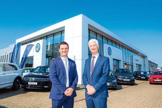 Director Jamie Cameron and chairman Douglas Cameron of Cameron Motor Group.
