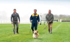 """Perth Races Preparations Photo, right, Donald Gow Head Grounds man, with  team members , Derek Halley & centre, Jack McFeat and Pet Lhasa Apso  """"Missy"""" trying the course."""