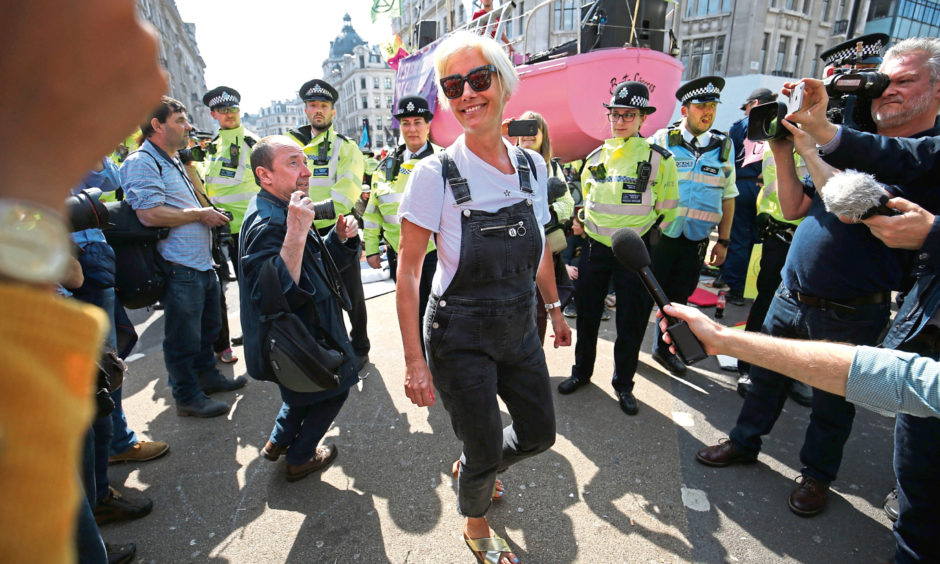 Actress Emma Thompson (centre) joins Extinction Rebellion demonstrators at Oxford Circus in London.