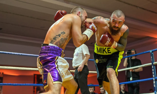 Mike Towell (right) died in hospital after collapsing in the fight against, Dale Evans (left).