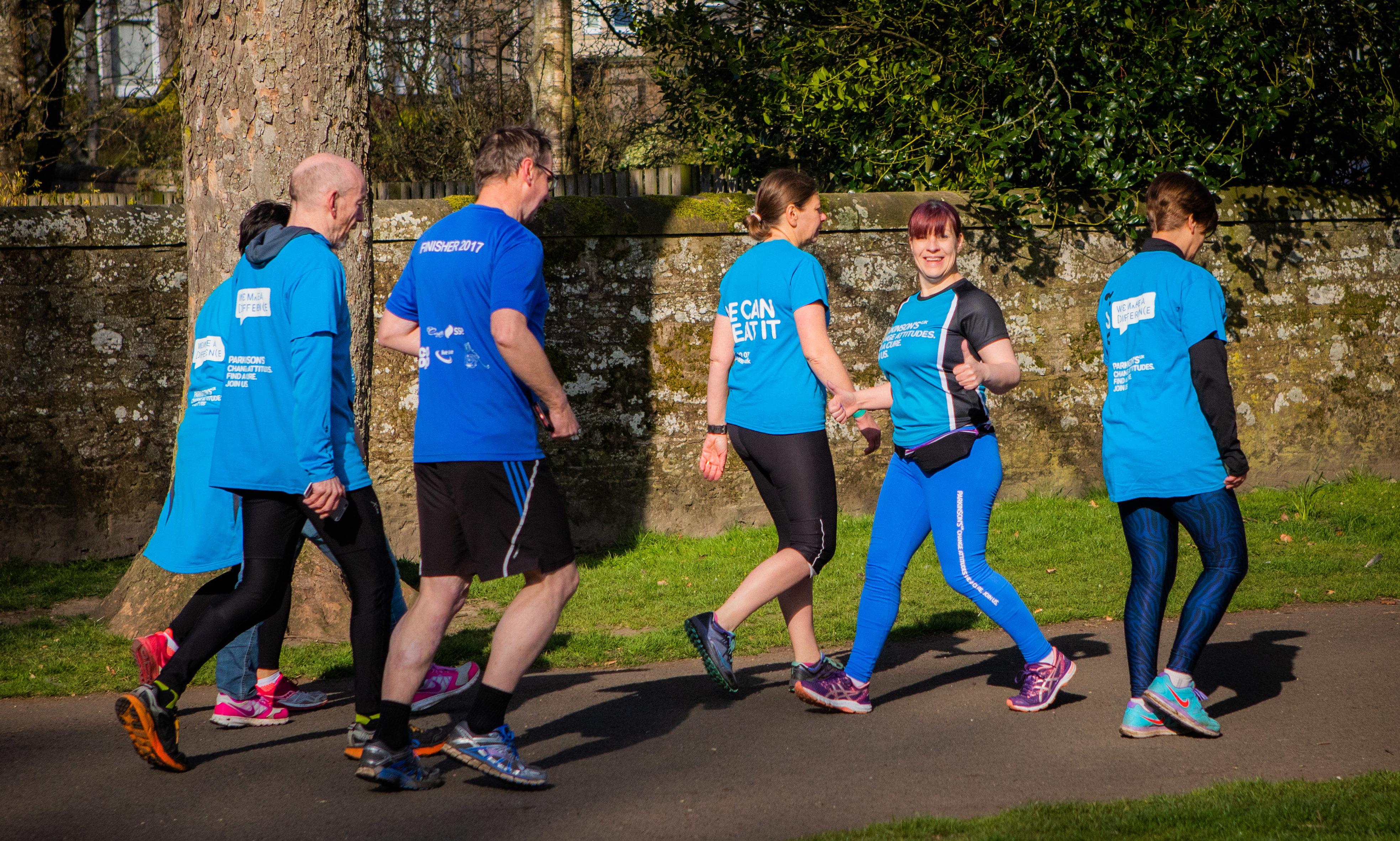 Jane Scott running backwards around North Inch, Perth, for Parkinsons UK