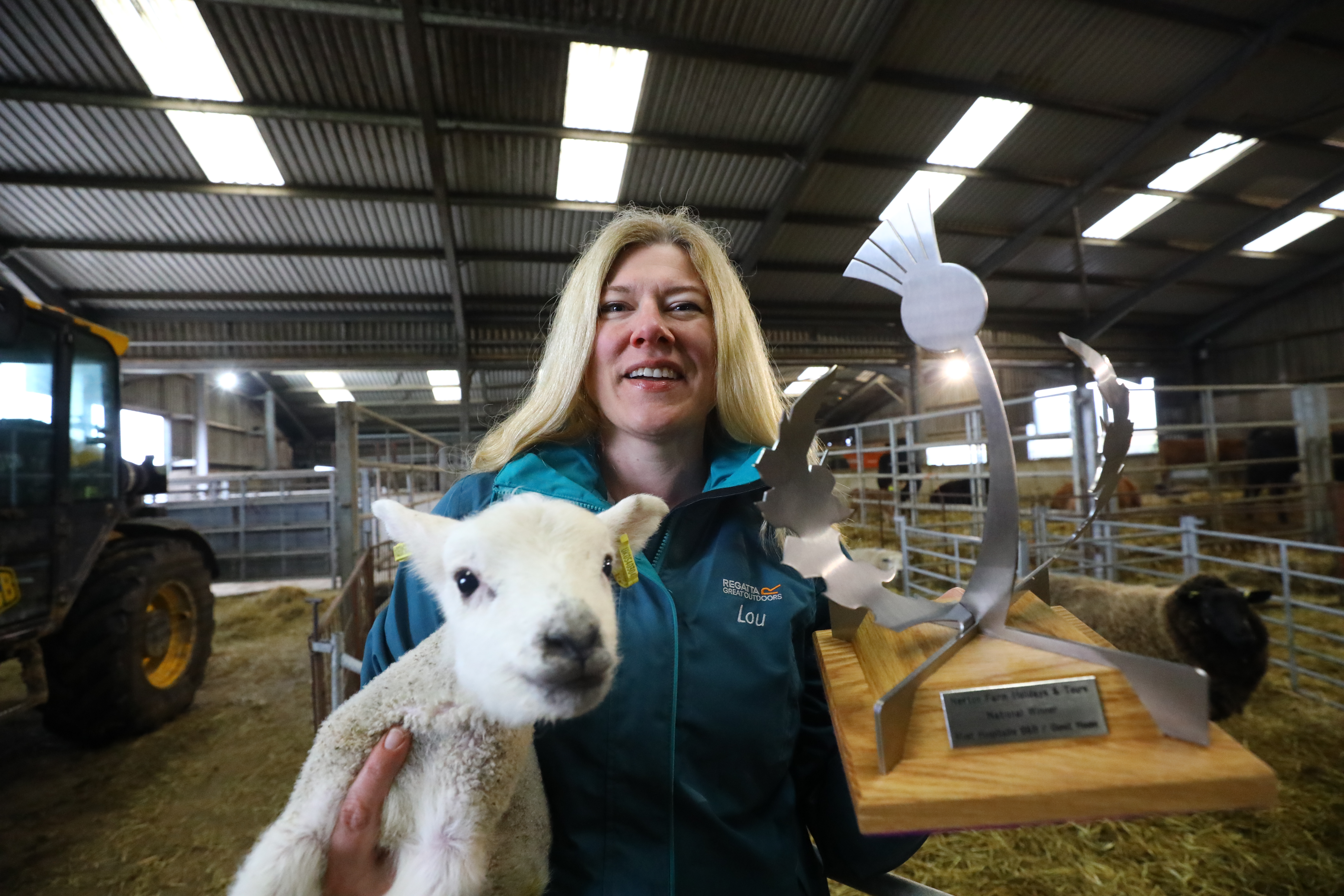 Louise Nicoll with her Scottish Thistle Award for Most Hospitable B&B/Guest House, and one of her lambs at Newton of Fothringham Farm, near Inverarity.