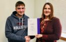 Daniel receives his scholarship from Amy Newton, branch co-ordinator for the MS Society in Scotland