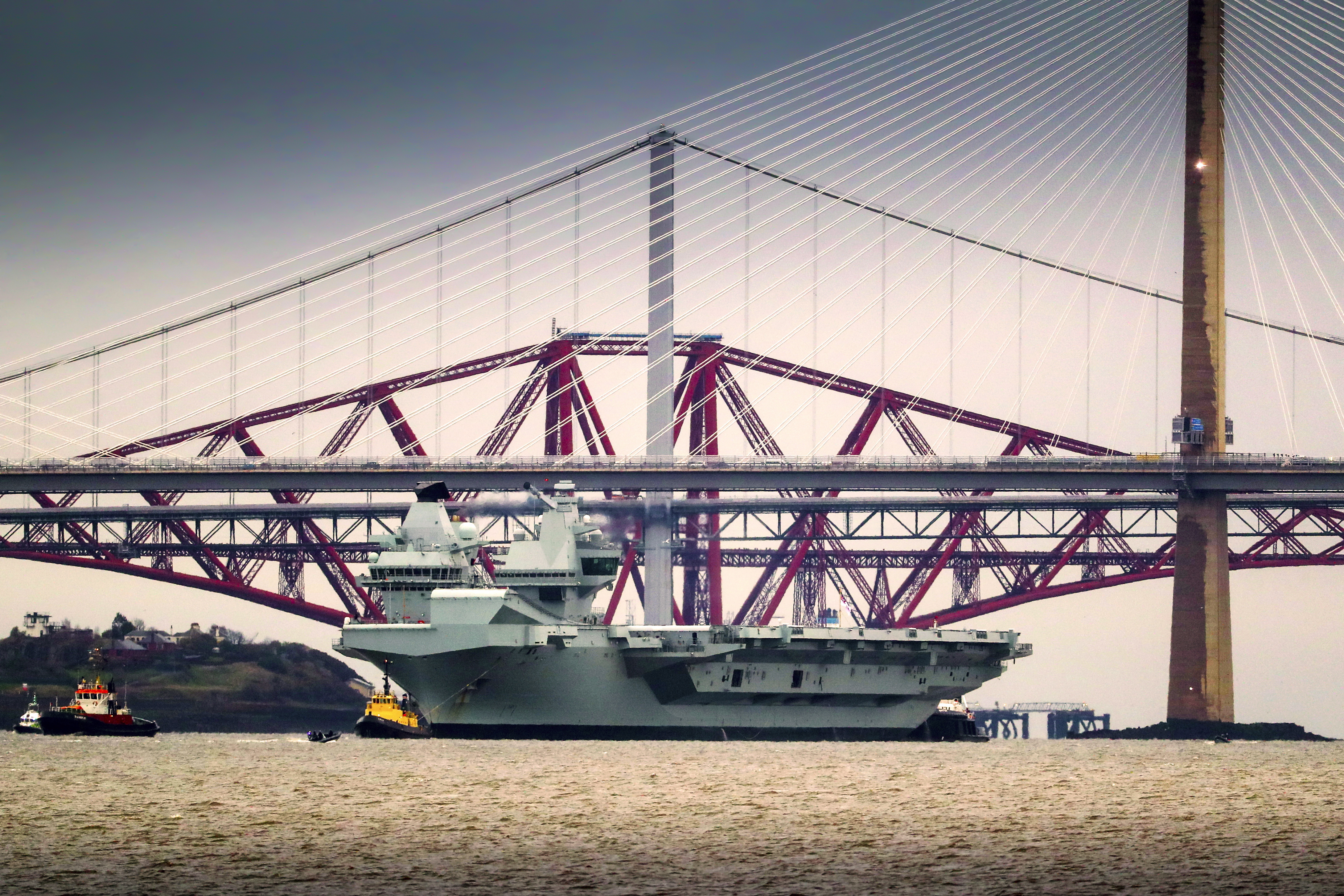 The Royal Navy aircraft carrier HMS Queen Elizabeth (Andrew Matthews/PA)