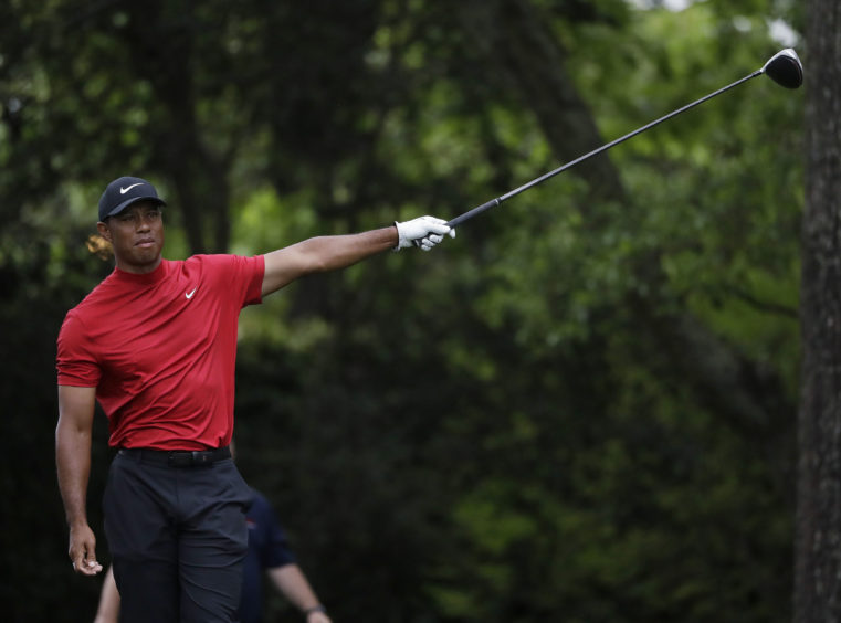 Tiger Woods reacts to his drive.