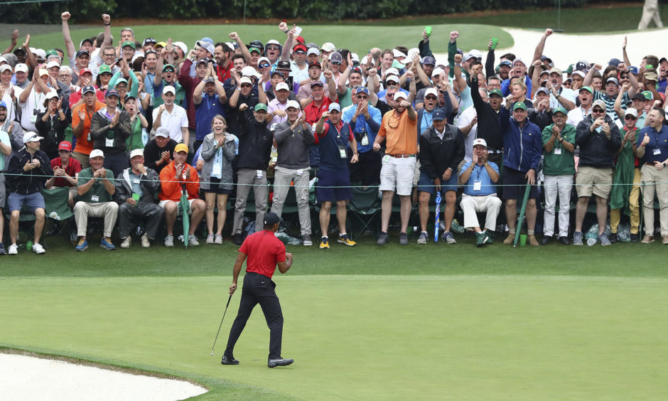 Tiger Woods reacts as he wins the Masters golf tournament.;