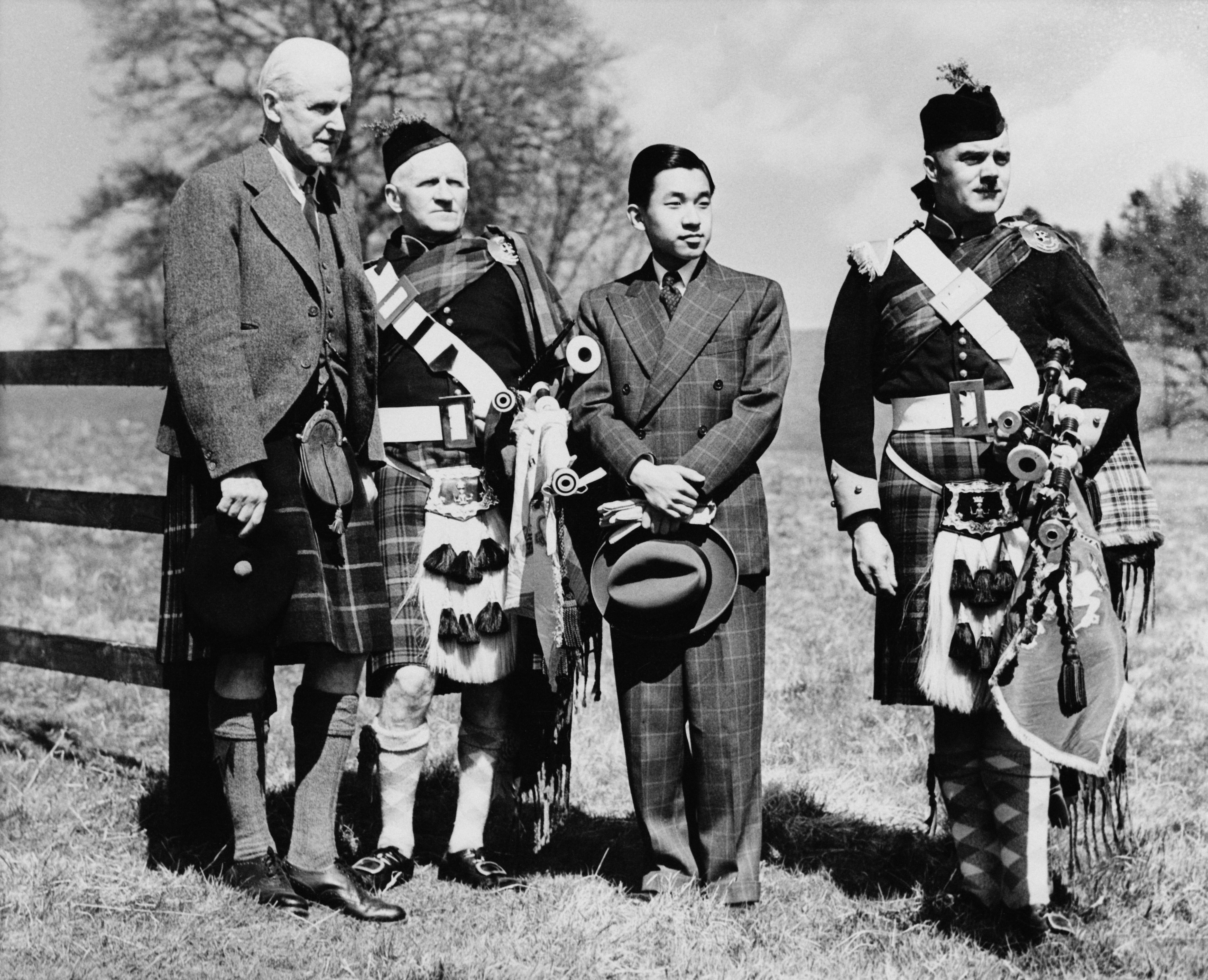 Akihito In Scotland. Crown Prince (later Emperor) of Japan, Akihito (second from right) during a visit to Blair Castle, Perthshire, Scotland, 9th May 1953. With him are James Stewart-Murray, 9th Duke of Atholl 1879 - 1957, far left), Pipe Major Peter Wilkie and piper Archibald Alves.