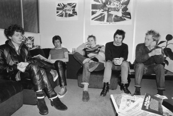 Notorious British punk rock band The Sex Pistols at the EMI studios, 2nd December 1976.  From left to right, manager Malcolm McLaren, Steve Jones, Johnny Rotten (John Lydon), Glen Matlock and Paul Cook.