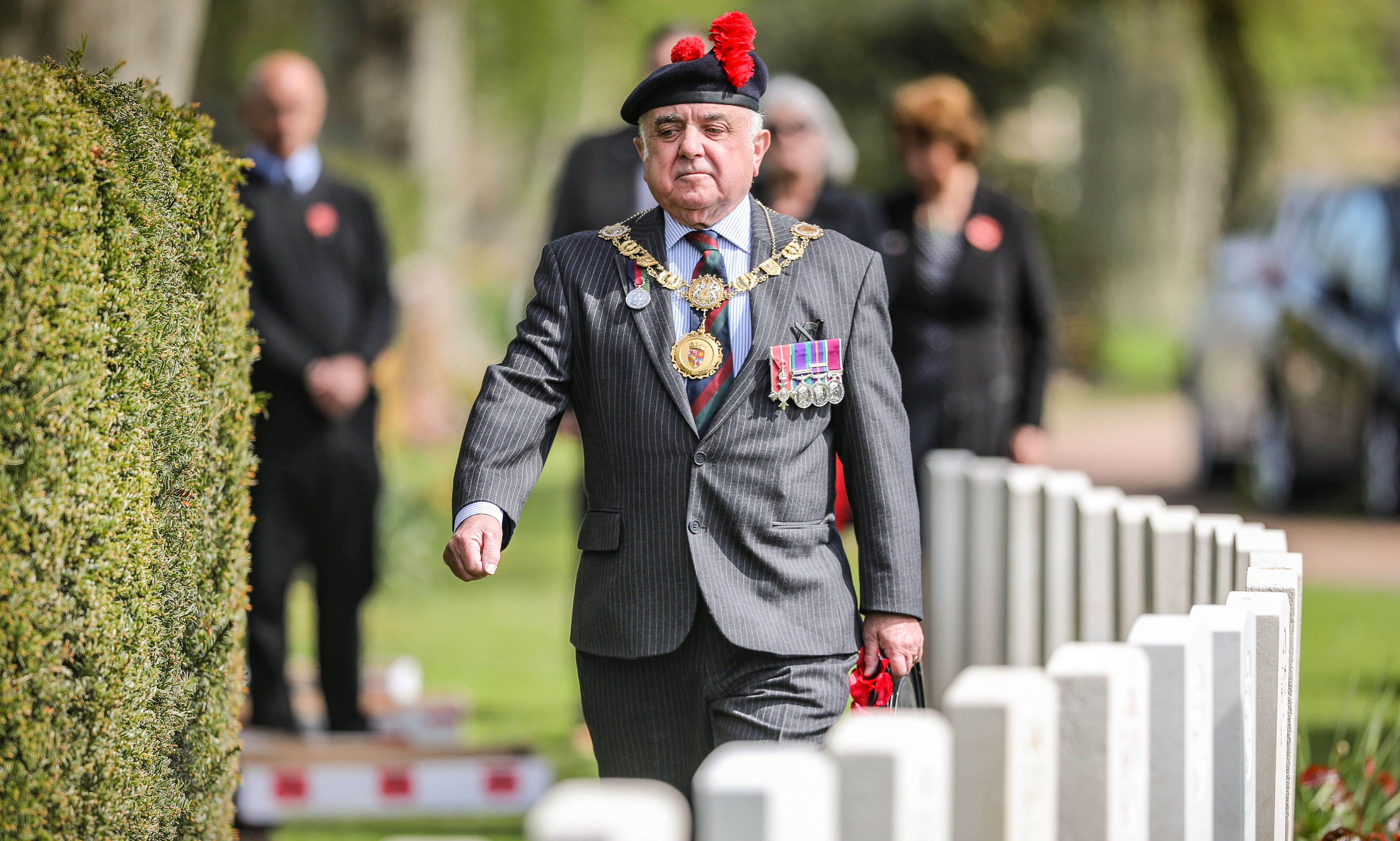 Major Ronnie Proctor, Provost of Angus, laying a wreath.