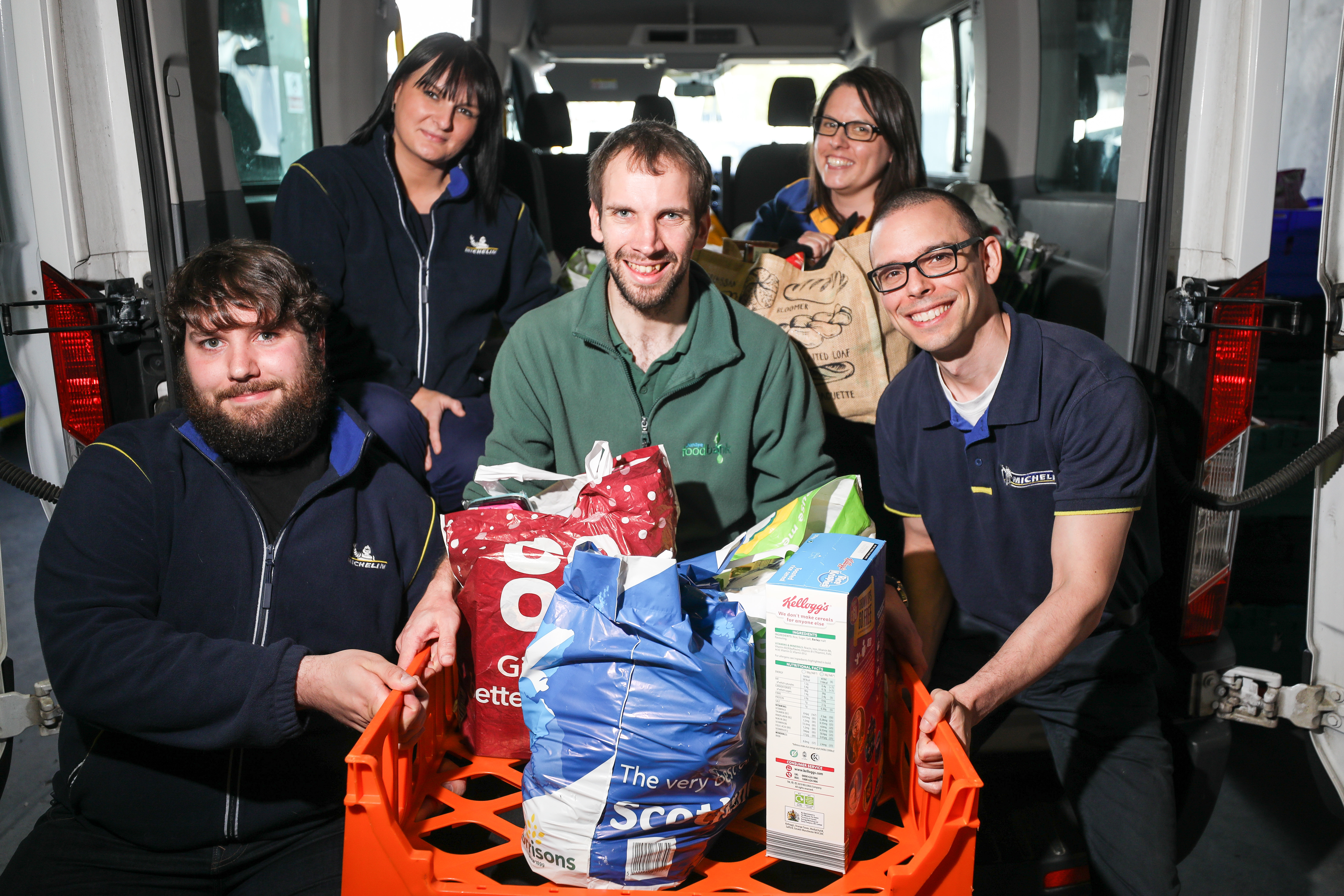 Michelin staff, from left, Scott Webster, Michelle Johnstone, Louise Smart and Peter Blanchard presenting the food to Michael Calder, stock coordinator at Dundee Foodbank.
