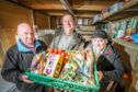 Norman Fox, distribution and driver, David Paton, Chair of Carnoustie Legion and Kirsty MacDonald, food handler and distributor, sorting out food donated by Tesco. Missing from the  picture is Gavin Wilson, the linchpin with FareShare.