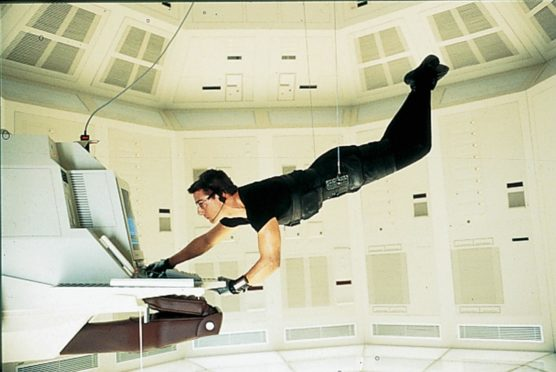 Tom Cruise in Mission Impossible.