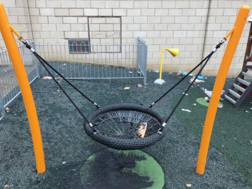 The damaged swing.