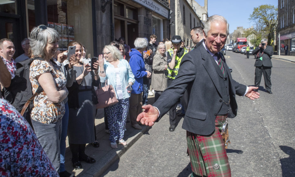 The Prince of Wales, known as the Duke of Rothesay while in Scotland, meets members of the public on Banff High Street after a visit to the Banff Museum in Banff, Aberdeenshire.